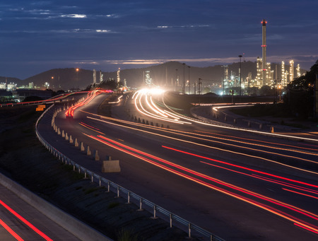 Beautiful lighting of oil refinery plant petrochemical industry with transport