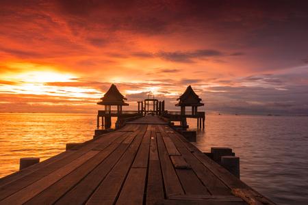 Twilight sunset wood bridge at Djittabhawan Temple tourist attraction in Pattaya, Thailand