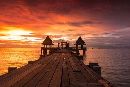 Twilight sunset wood bridge at Djittabhawan Temple tourist attraction in Pattaya, Thailand