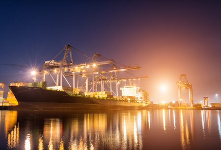blue vessels: Containers loading by crane on morning dark, Trade Port , Shipping , transport Stock Photo