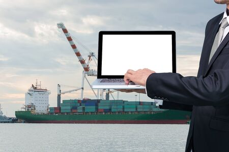 conputer: Engineering working hold conputer notebook in front of industrial harbor cargo Stock Photo