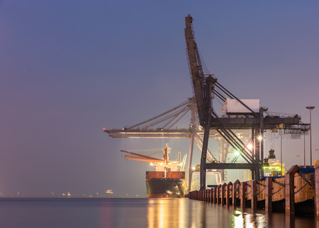 water transportation: Containers loading by crane on morning dark, Trade Port , Shipping , transport Stock Photo