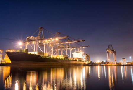 sea port: Containers loading by crane on morning dark, Trade Port , Shipping , transport Stock Photo