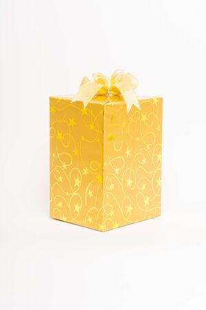 elaborate: Gold gift box with bow isolate on over white background