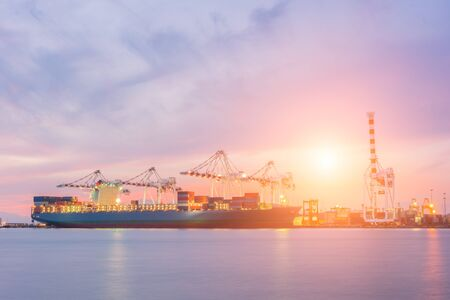 Industrial Container Cargo freight ship with working crane bridge Stock Photo