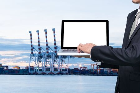 manage transportation: Engineering working hold conputer notebook in front of industrial harbor cargo Stock Photo