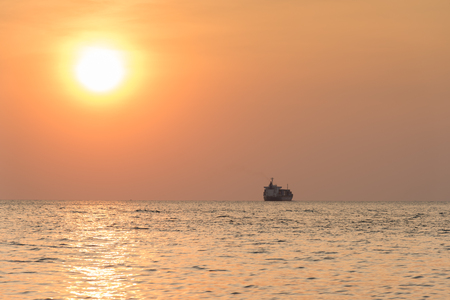 tranfer: Cargo container ship at the sea in sunset Stock Photo