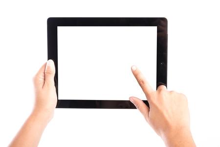 タブレット コンピューターと指タッチの画面を保持している女性の手が白い背景の分離します。 写真素材