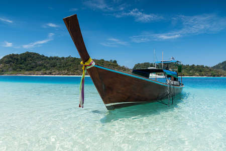 long tailed boat: Long tailed boat on the sand beach at KohRook island south of Thailand