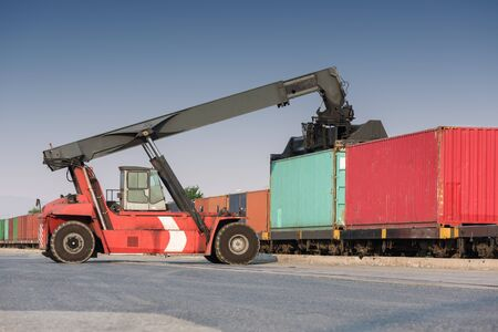 moving truck: Forklift moving containers at the Docks with Truck