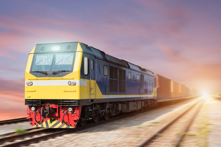 diesel locomotives: Fast freight blue train at sunset with motion blur
