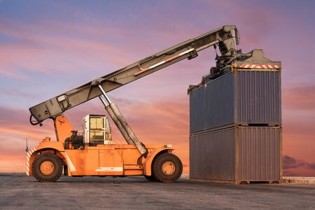 reach truck: Forklift handling container box loading at the Docks with Truck Stock Photo