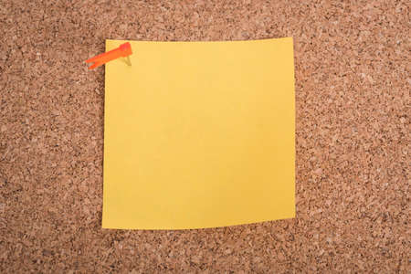 yellow tacks: Yellow blank note papers with pin on wooden board background