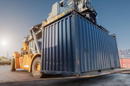 container box: forklift handling container box loading from dock to truck
