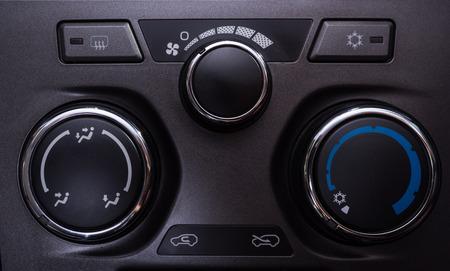 modern interior: Car interior Air conditioning buttons control close up modern car