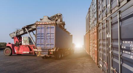 handling: Forklift handling the containers box in the port at Thailand Stock Photo