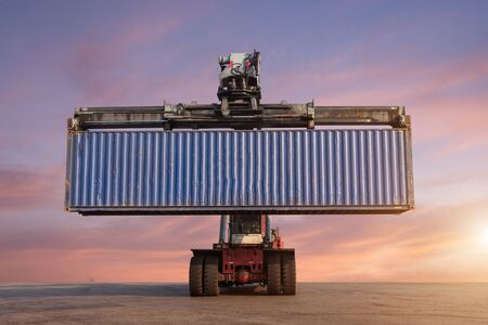 reach truck: Forklift handling container box loading in the port at Thailand at sunset