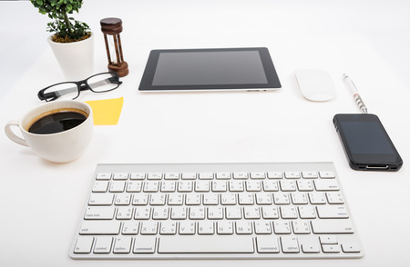 Digital tablet touch pad computer with keyboard, mouse and coffee in Office workplace table business Standard-Bild