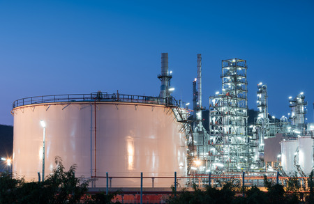 petrol bomb: Oil refinery gas industry plant of petroleum industry production at sunset Stock Photo