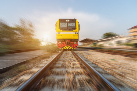 diesel train: High speed diesel train on tracks with motion blur at sunset