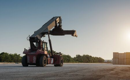 reach truck: Forklift handling no container box loading at sunset