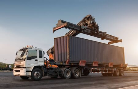 reach truck: Forklift handling container box loading at the Docks to Truck