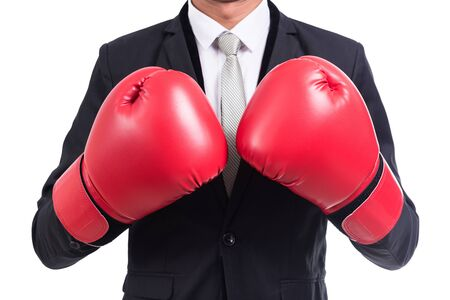 Businessman standing posture with boxing gloves isolated on over white background Stock Photo