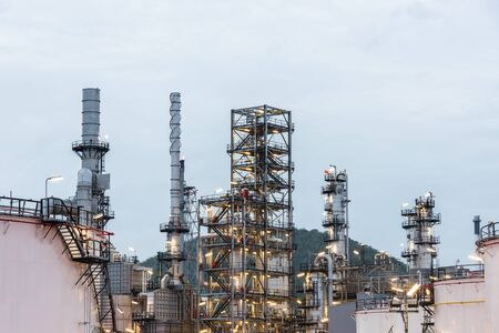 Oil refinery and Petroleum industry at night time, sunset, petrochemical industrial Stock Photo