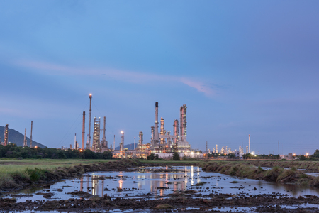 Oil petrochemical refinery plant at sunset twilight