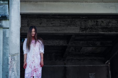 Zombie Ghost woman murder with bloody stand on abandoned building ,halloween concept Stock Photo