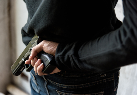 Man hid gun behind their back, robbery, crime, kidnapping