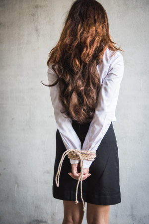 Young Woman hands tied with a rope kidnapped concept