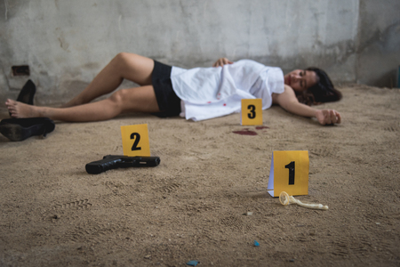 Body young woman girl dead was thief violence sexual raped and killed on floor ground at abandon house