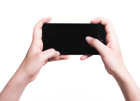 Female hand holding mobile smartphone play game gamer blank black screen isolated on over white background