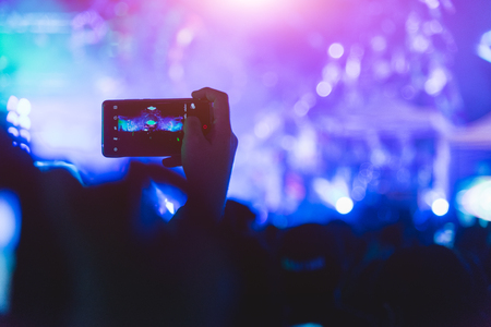 Event people live video festival music concert by hand holding smart mobile phone