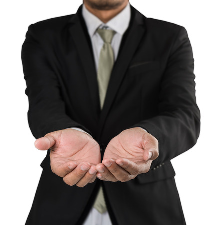 businessman holding hand outstretched forward isolate on white background