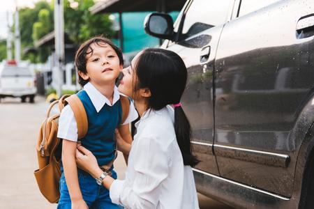 Family happy mother mom send children kid son boy kindergarten to school, education back