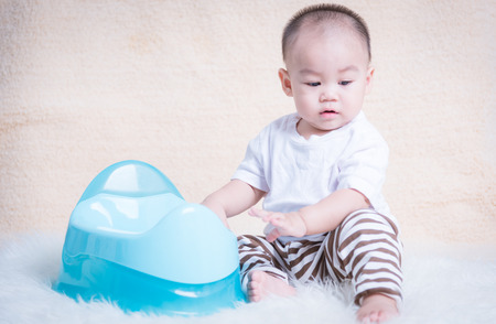 Baby Childrens sitting chamber pot 10 Month Stock Photo