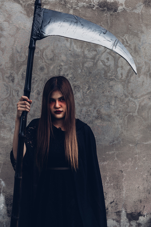 Portrait woman ghost demon she holding reaper, halloween concept Imagens