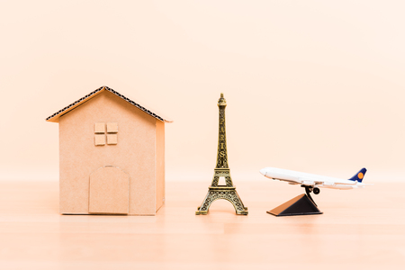 Cardboard paper model house, eiffel tower and plane airplane, paris travel business