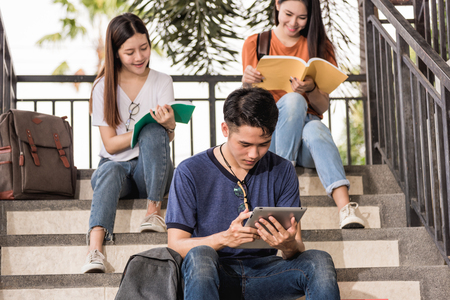 Male and female students intend to read book at university, Education concept