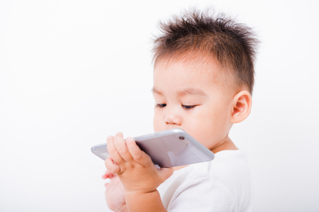 Asian portrait child boys 1 year 6 months holding smartphone on hand on white background