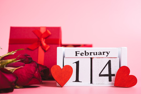 Red wood Hearts and gift box on pink background, 14 February, valentine day concept Stock Photo
