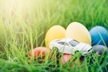 Easter egg and Car on grass background, happy easter day concept