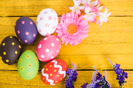 Easter eggs top view on yellow wooden background and have copy space for use