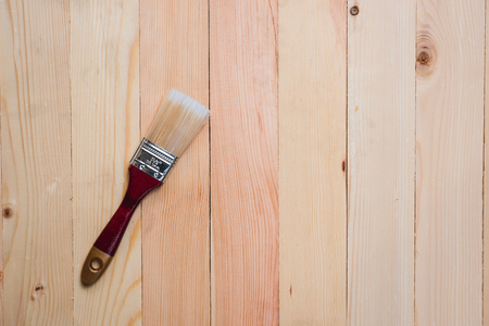 Top view of paint brush on wooden pallet texture for copy space background Standard-Bild - 120841749
