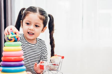 Beautiful kid girl play loop toy education at home before preschool