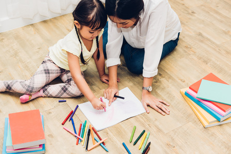 Child kid girl kindergarten drawing teacher education mother with beautiful mother at interior room home