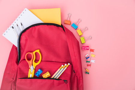 Top view Red bag backpack for education children on pink background back to school concept