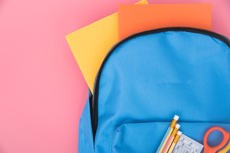 Blue bag backpack for education children on pink background back to school concept